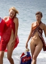 Completely naked girls nudists on the beach