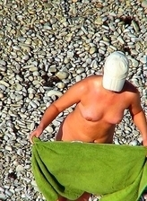 Hot matures get filmed while sun tanning their bodies at Nude Beach Dreams
